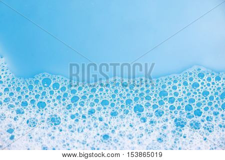 Abstract background of soap foam, suds, shower. Blue background. soft focus, macro view