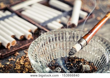 Closeup Of Fuming A Cigarette In The Old Pipe