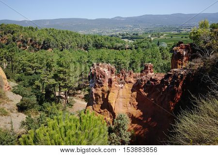 Orange ochre picturesque hills.Roussillon Provence France. Preserve natural dye production - ocher.