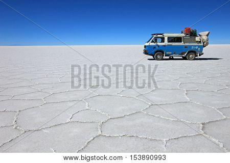 Van on Salar de Uyuni, salt lake, is largest salt flat in the world, altiplano, Bolivia, South America