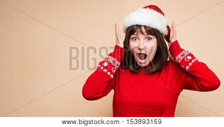 Christmas stress - woman wearing santa hat stressing for christmas shopping with copyspace for your text. Funny image of shouting santa girl.