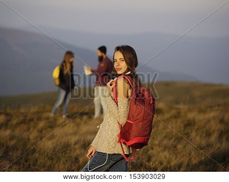 Girl With Backpack On Mountain