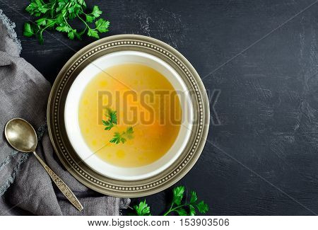 Homemade chicken bouillon or broth view from above