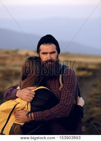 Embracing Couple On Mountain Top
