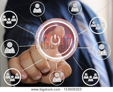 Businessman pressing 2017 on virtual screens. Business concept - businessman pressing icon in 2017 on touch screens.Business innovation,business vision , webinar, startup, in 2017.