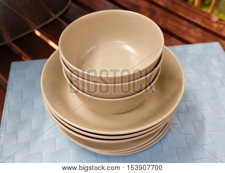 Kitchen Utensil Set of Brown Porcelain Dishes Bowls and Plates Preparing for Serve Hot and Cold Food.