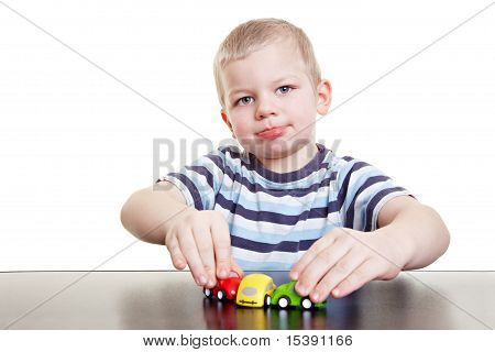 Happy Child Playing With Cars