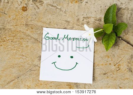 good morning message card greeting and white flowers on background old wood