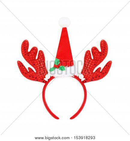 Pair Of Headband Reindeer Horns And Santa Hat Isolated On White Background