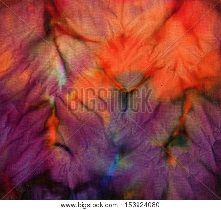 Tie dye pattern abstract background. Rich red and purple
