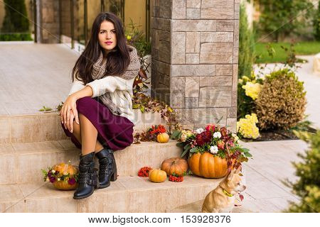 Pretty Woman Sitting On A Decorated Porch
