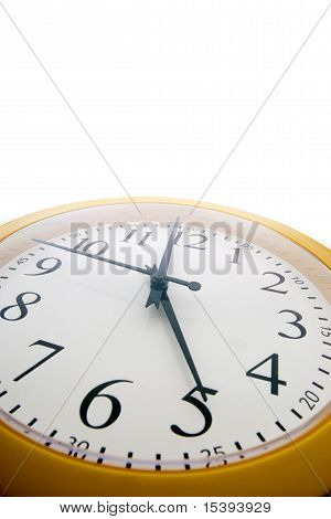 Wide Angle Close Up Of An Analog Clock Just Before The End Of The Workday At 5 Pm