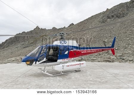 Mount Cook, New Zealand - February 2016: Helicopter From The Helicopter Line Company Landing On Snow