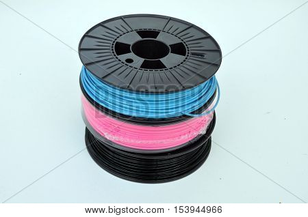 3D printing filament spools stacked on top of each other