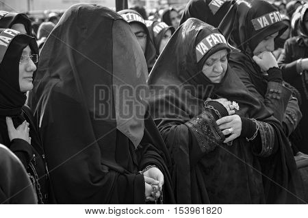 Istanbul Turkey - November 3 2014: Universal Ashura Mourning Ceremony. Day of Ashura. Turkish Shia women mourn during an Ashura procession. A Universal Ashura Mourn Ceremony was held in Istanbul to commemorate the martyrdom of Husain ibn Ali