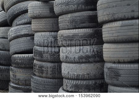 old worn out tires heap for recycling or scrap
