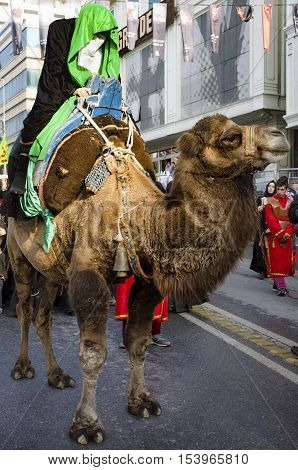 Istanbul Turkey - October 11 2016: Representation on the camels to revive Karbala in the seventh century takes part in an Ashura parade. Turkish Shia Muslims mourning for Imam Hussain.