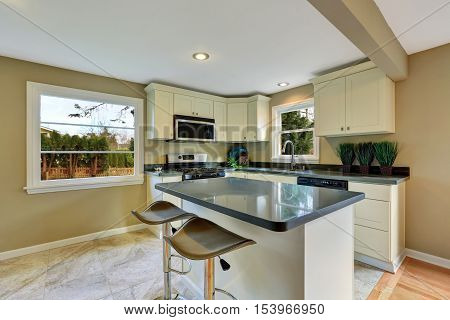 Open Floor Plan White Kitchen Room With Island And Dining Area