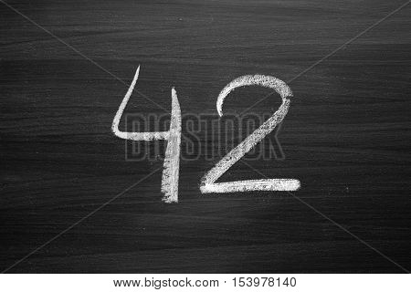 number forty two enumeration written with a chalk on the blackboard