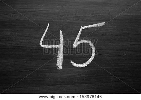 number forty five enumeration written with a chalk on the blackboard