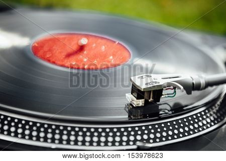 turntable with LP vinyl record, closeup view