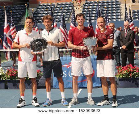 NEW YORK - SEPTEMBER 10, 2016: Guillermo Garcia-Lopez ESP (L) ,Pablo Carreno Busta ESP, Jamie Murray GBR and  Bruno Soares BRA during trophy presentation after US Open 2016 men doubles final