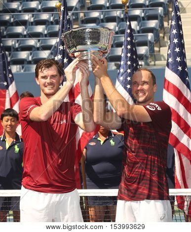 NEW YORK - SEPTEMBER 10, 2016: US Open 2016 men doubles champions Jamie Murray (L) of Great Britain and Bruno Soares of Brazil during trophy presentation at the Billie Jean King National Tennis Center