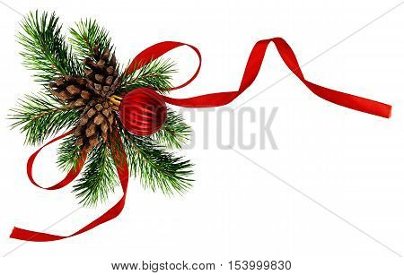 Christmas arrangement with pine twigs cones and red silk ribbon bow isoaletd on white