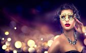 Beauty model woman wearing venetian masquerade carnival mask at party over holiday dark background w poster