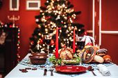 Christmas Dinner By Candlelight, Table Setting. Thanksgiving Table With Baked Turkey In A Decorated poster