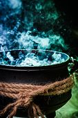 Постер, плакат: Closeup Of Witcher Cauldron With Blue Mixture For Halloween