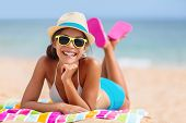 Summer woman relaxing in hipster beach hat and colorful sunglasses. Funky happy girl having fun duri poster