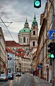 picture of saint-nicolas  - Street of Prague with baroque Saint Nicolas church - JPG
