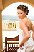 Sexy Young Brunette Bride Wearing White Wedding Gown