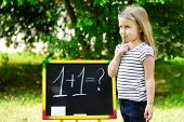 Adorable Funny Little Girl At Blackboard Practicing Counting And Math poster