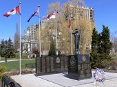 stock photo of burlington  - A war memorial for the HMCS Burlington from the II world war on the  shore of lake Ontario with new high rise condominium behind.   - JPG