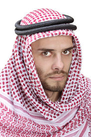 foto of muslim man  - Portrait of a young Arabic man wearing a turban isolated on white background - JPG