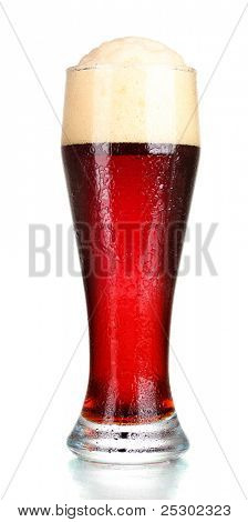 red beer with foam in glass isolated on white