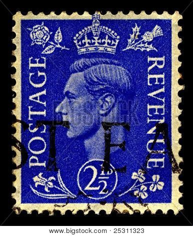 UK-CIRCA 1941:A stamp printed in United Kingdom shows image of George VI (Albert Frederick Arthur George) was King of the UK and the Dominions of the British Commonwealth, circa 1941.