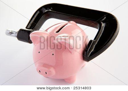 Piggy bank in a vice