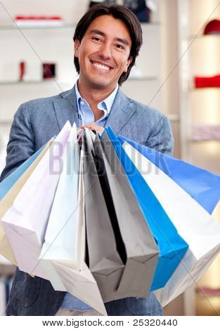 Man holding shopping bags at a retail store