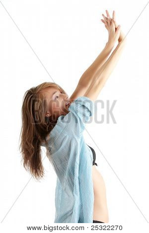 Young beautiful morning woman in big shirt and underwear  stretching