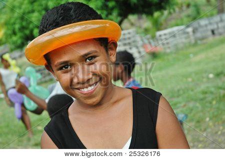 Smiling Fijian school girl with balloon around head