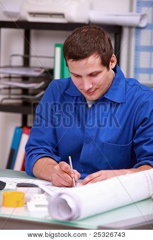 Manual laborer sitting at a desk