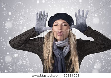 Winter Girl In Wool Cap And Gloves