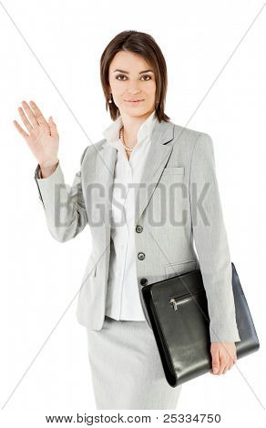 Smiling businesswoman on white background, holding briefcase waving