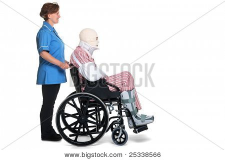 Photo of an hospital patient with multiple injuries being helped by a female nurse. Isolated on a white background.