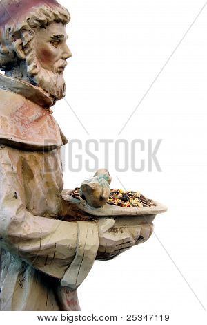 St. Francis statue with bowl of bird seed