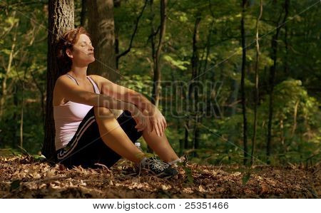 Mature woman runner resting.
