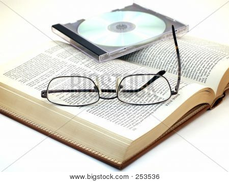 Glasses & CD On Book